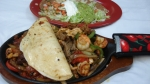 Fajita Casa Blanca (Single) - Tender strips of steak, beef, shrimp, chicken and chorizo (Mexican sausage). Served with rice, beans, salad, and one cheese quesadilla.